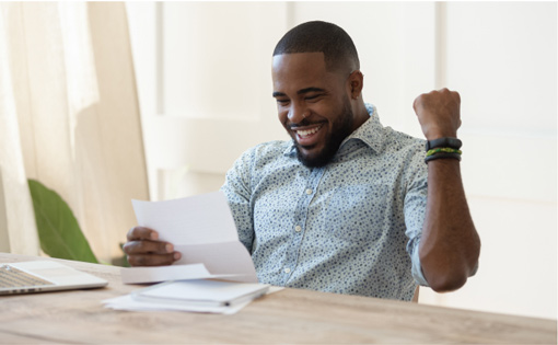 Man excited while reading employment offer.