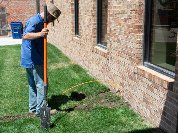 Bury fiber optic cable in lawn.