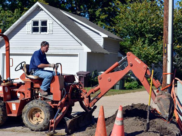 Hamilton employee burying fiber.
